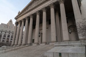 Courthouse steps with pillars on government building.
