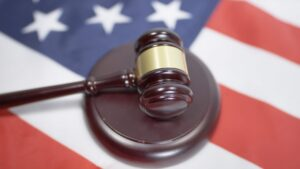 A legal gavel on an American flag